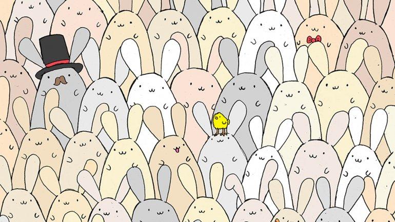 El huevo de Pascua se esconde entre muchos conejos
