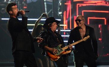 Rapper Pitbull, Joe Perry y Robin Thicke